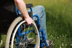 Hombre en una silla de ruedas Imágenes de archivo libres de regalías