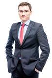 Hombre en vidrios y traje de negocios 25 años de edad en un blanco Fotos de archivo libres de regalías