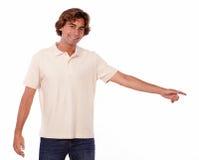 Hombre encantador que señala a su izquierda Imagen de archivo libre de regalías