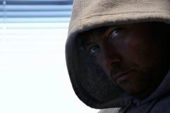 Hombre encapuchado Foto de archivo libre de regalías