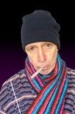 Hombre enfermo en negro Imagenes de archivo