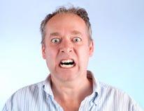 Hombre enfurecido sobre algo Imágenes de archivo libres de regalías