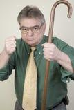 Hombre enojado con el bastón foto de archivo libre de regalías