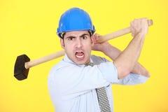 Hombre enojado con el martillo Fotografía de archivo libre de regalías