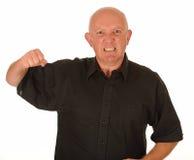 Hombre enojado con el puño levantado Imágenes de archivo libres de regalías