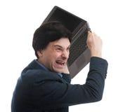 Hombre enojado con la computadora portátil Fotos de archivo