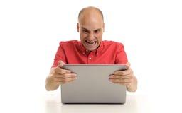 Hombre enojado con la computadora portátil Imágenes de archivo libres de regalías