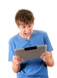 Hombre enojado con la tableta Imagenes de archivo