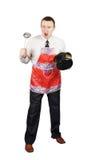 Hombre enojado con los accesorios de la cocina Imagenes de archivo