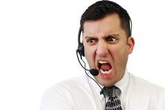 Hombre enojado del servicio de atención al cliente Fotos de archivo