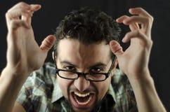Hombre enojado en negro Fotos de archivo
