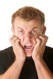 Hombre enojado que agarra su cara Imagen de archivo libre de regalías