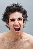 Hombre enojado que grita Fotos de archivo