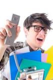 Hombre enojado que grita sobre el teléfono, aislado en blanco Fotos de archivo libres de regalías