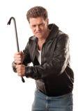 Hombre enojado que sostiene una palanca Imagenes de archivo