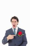 Hombre enojado y chocado adulto en traje con la expresión de la cara del repugnancia Foto de archivo
