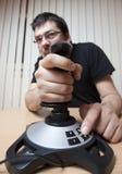 Hombre enrrollado con una palanca de mando Fotos de archivo libres de regalías