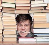 Hombre entre los libros Imagen de archivo libre de regalías