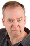 Hombre envejecido medio gruñón imagen de archivo libre de regalías