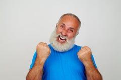 Hombre envejecido que gesticula el nerviosismo aislado en blanco Imagen de archivo libre de regalías