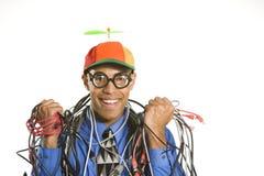 Hombre envuelto en cables. Foto de archivo libre de regalías