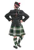 Hombre escocés en la presentación trasera del traje nacional tradicional Imagen de archivo libre de regalías