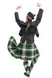 Hombre escocés en la presentación trasera del traje nacional tradicional Fotografía de archivo libre de regalías