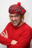 Hombre escocés enojado Imagen de archivo libre de regalías