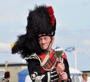 Hombre escocés tradicional en los juegos de Nairn Highlanf Foto de archivo
