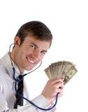 Hombre, estetoscopio y dinero imagen de archivo libre de regalías