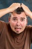Hombre extremadamente frustrado Foto de archivo libre de regalías