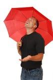 Hombre feliz bajo un paraguas Imágenes de archivo libres de regalías