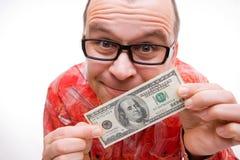 Hombre feliz con cientos cuentas de dólar Imagen de archivo
