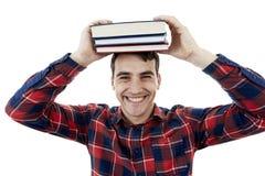 Hombre feliz con el libro en su cabeza fotografía de archivo libre de regalías