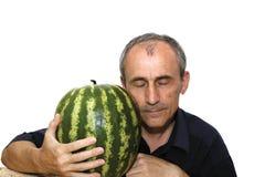 Hombre feliz con la sandía Imagen de archivo libre de regalías