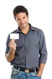 Hombre feliz con la tarjeta blanca Imagen de archivo libre de regalías