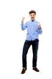 Hombre feliz con las manos aumentadas para arriba Imagen de archivo libre de regalías