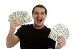 Hombre feliz con las porciones de dinero Fotografía de archivo libre de regalías