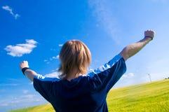 Hombre feliz con los brazos para arriba Imagen de archivo libre de regalías