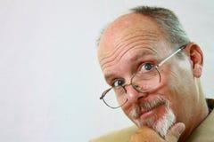 Hombre feliz con los vidrios en su nariz. Imagen de archivo libre de regalías