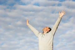 Hombre feliz con sus manos para arriba Imágenes de archivo libres de regalías
