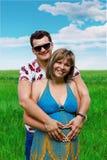 Hombre feliz de los pares y muchacha embarazada Imágenes de archivo libres de regalías