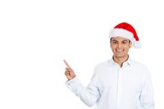 Hombre feliz de Navidad que señala a su izquierda Fotografía de archivo