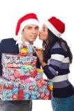 Hombre feliz de Santa que es besado por la mujer Imágenes de archivo libres de regalías