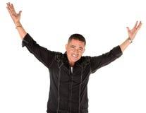 Hombre feliz del latino con los brazos levantados foto de archivo libre de regalías
