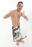 Hombre feliz en troncos de natación Foto de archivo libre de regalías