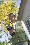 Hombre feliz hacia fuera para pescar Foto de archivo
