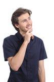 Hombre feliz hermoso que piensa y que mira el lado Imagen de archivo