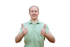 Hombre feliz joven con los pulgares para arriba Imagen de archivo