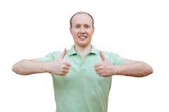 Hombre feliz joven con los pulgares para arriba Foto de archivo libre de regalías
